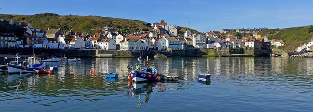 Staithes [pron. locally as 'Steeaz'] Harbour at high tide. Roxby Beck enters the harbour under a bridge at far right