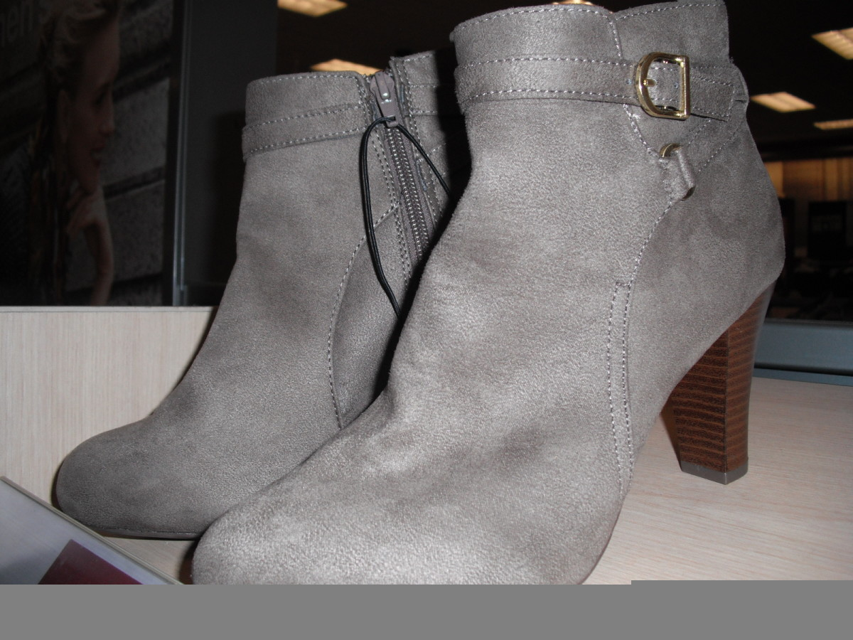 The modest buckles and straps don't interfere with the line of these ankle boots.