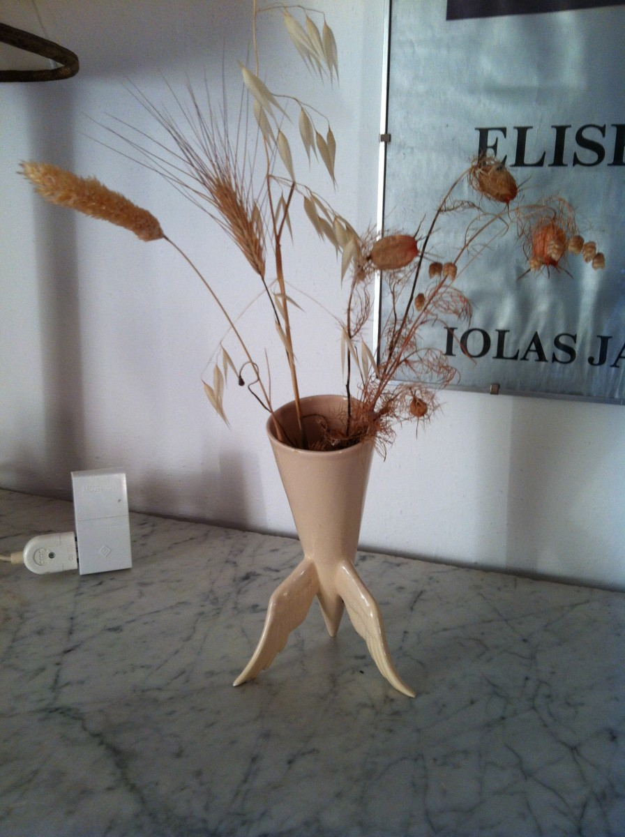 Dry summer grasses in a bric a brac vase