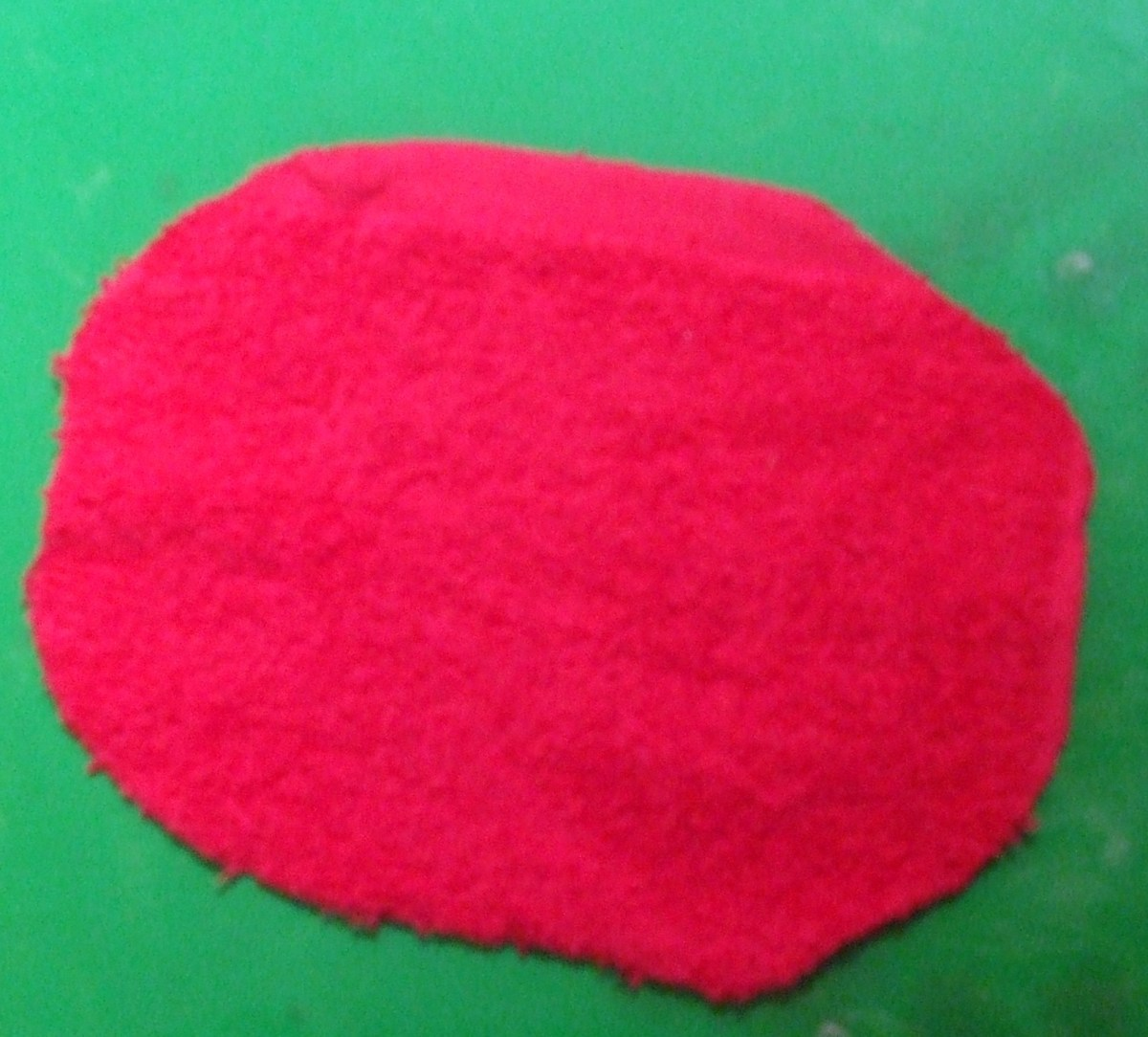 An oval of red fabric for the ladybug costume's back.