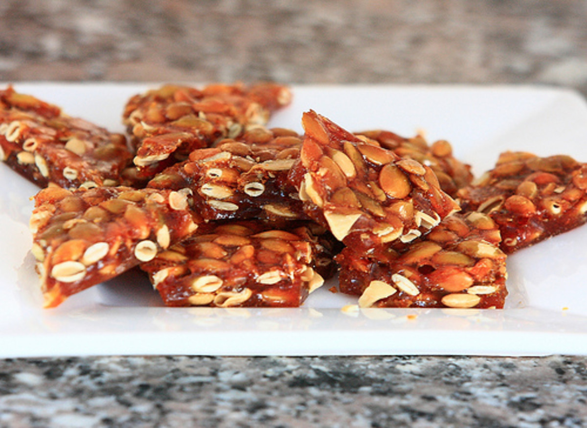 Brittle with assorted nuts and seeds, including pumpkin seeds.