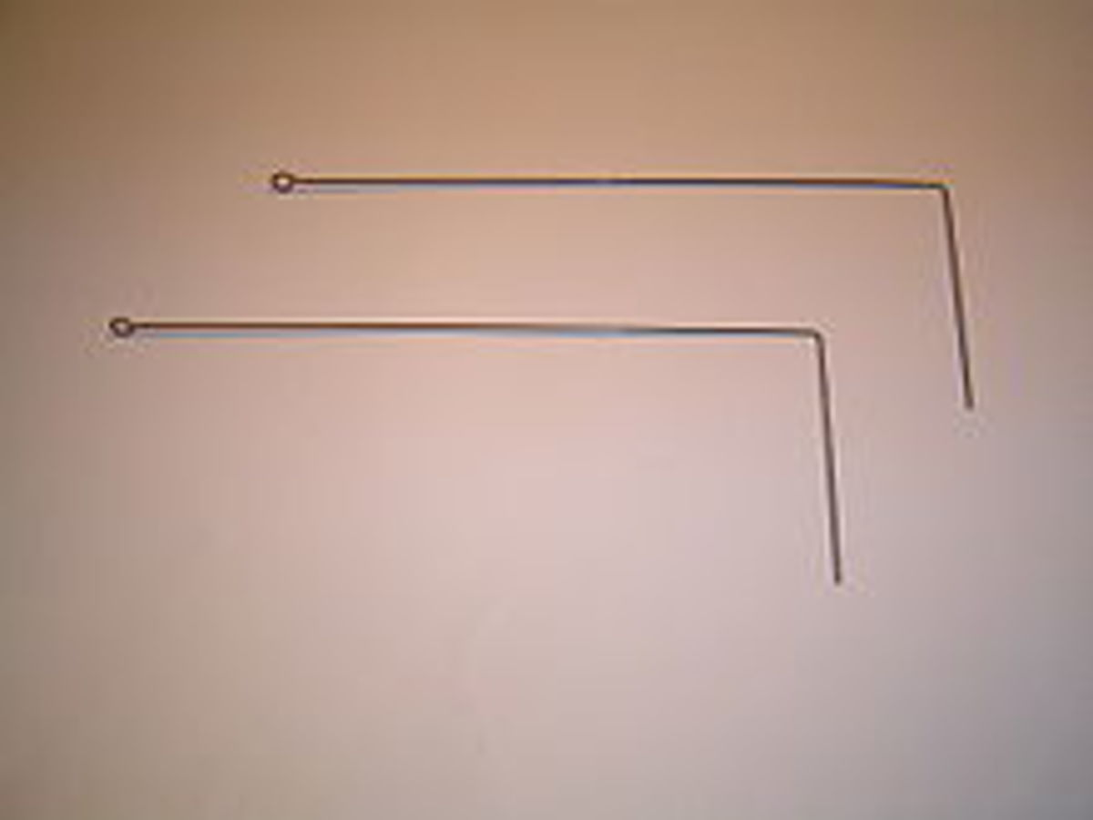 These L-Shaped wire rods are one form of a divining rod used to dowse for water.