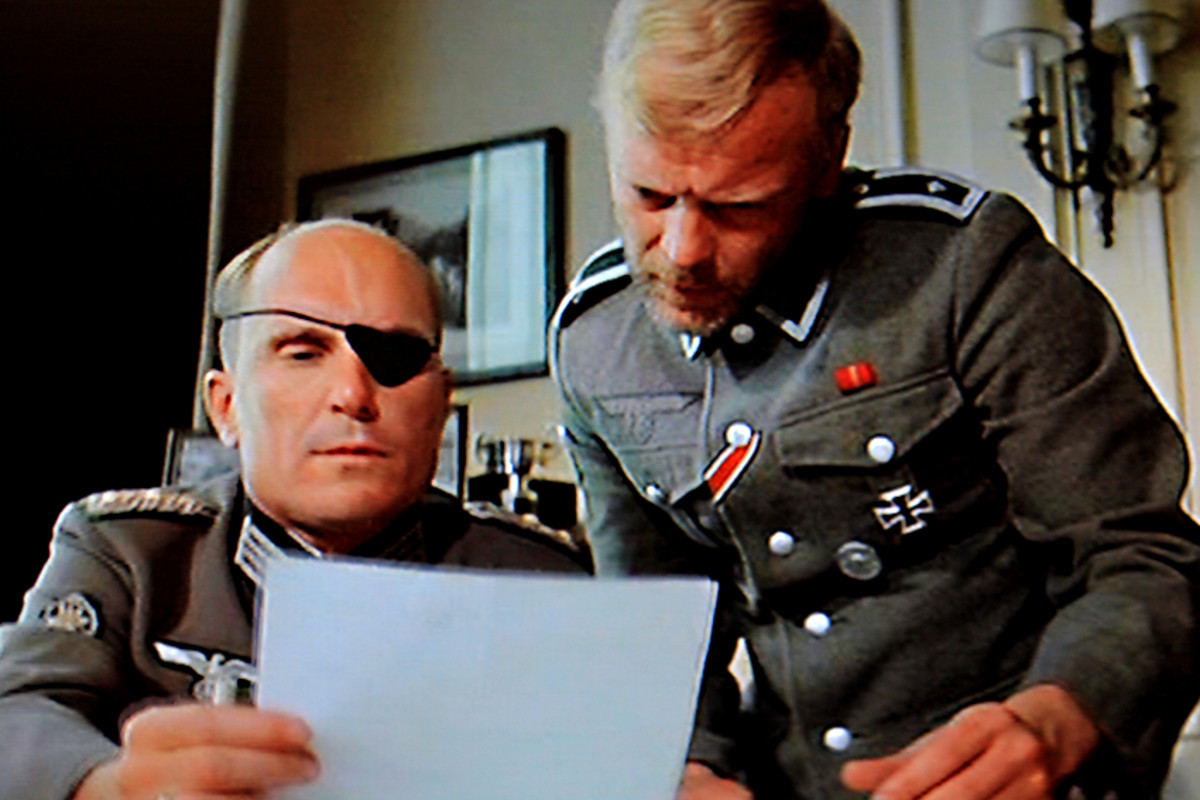 Colonel Radl ( Robert Duvall) and his assistant Karl concoct a plan to kidnap or assassinate Winston Churchill. All they need now is to find the right man for the job