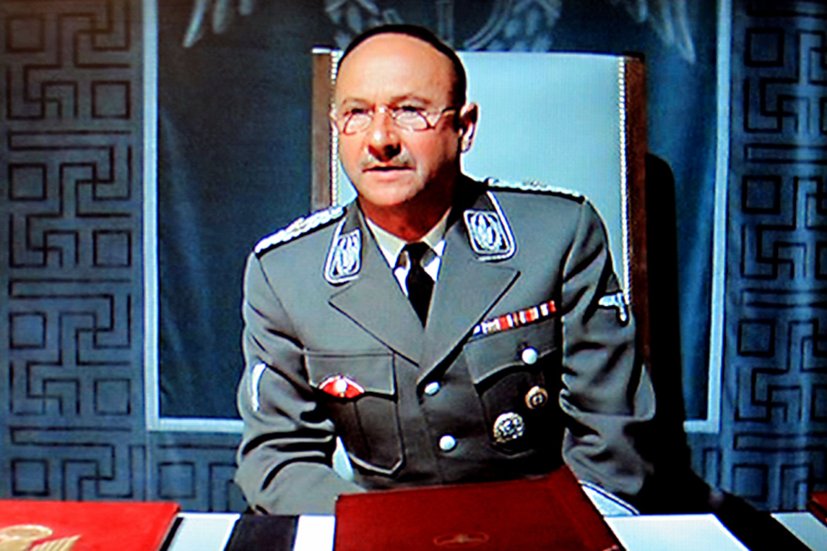 Donald Pleasence plays Heinrich Himmler, the Chief of Adolf Hitler's S.S.