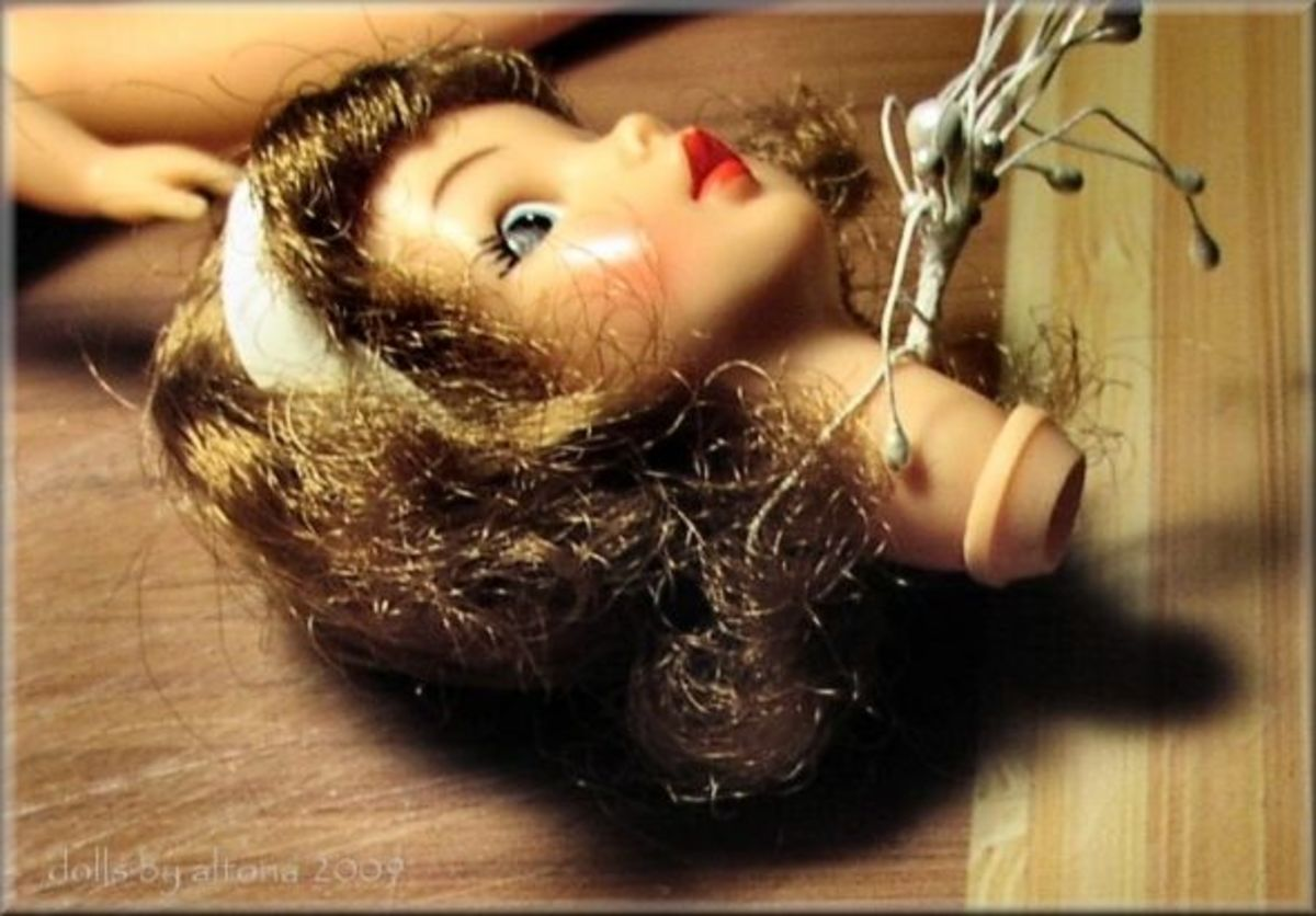 The torn area of the neck ring was glued surface to surface to the neck without any overlapping.  The neck ring was held in the attached position until the glue had set.  Once the glue set, the doll's hair was addressed. Based on the doll's hair an