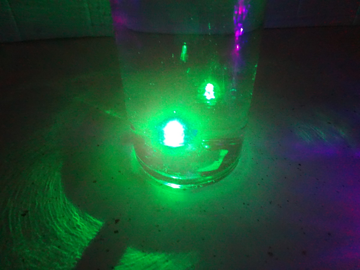 A waterproof LED in a vase with water.
