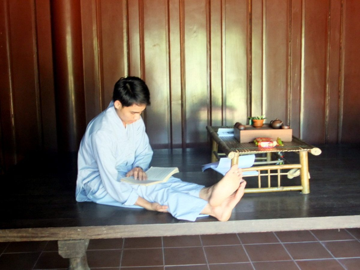 Student monk studying in one of the building which I suspect is also his lodging area, at Thien Mu pagoda