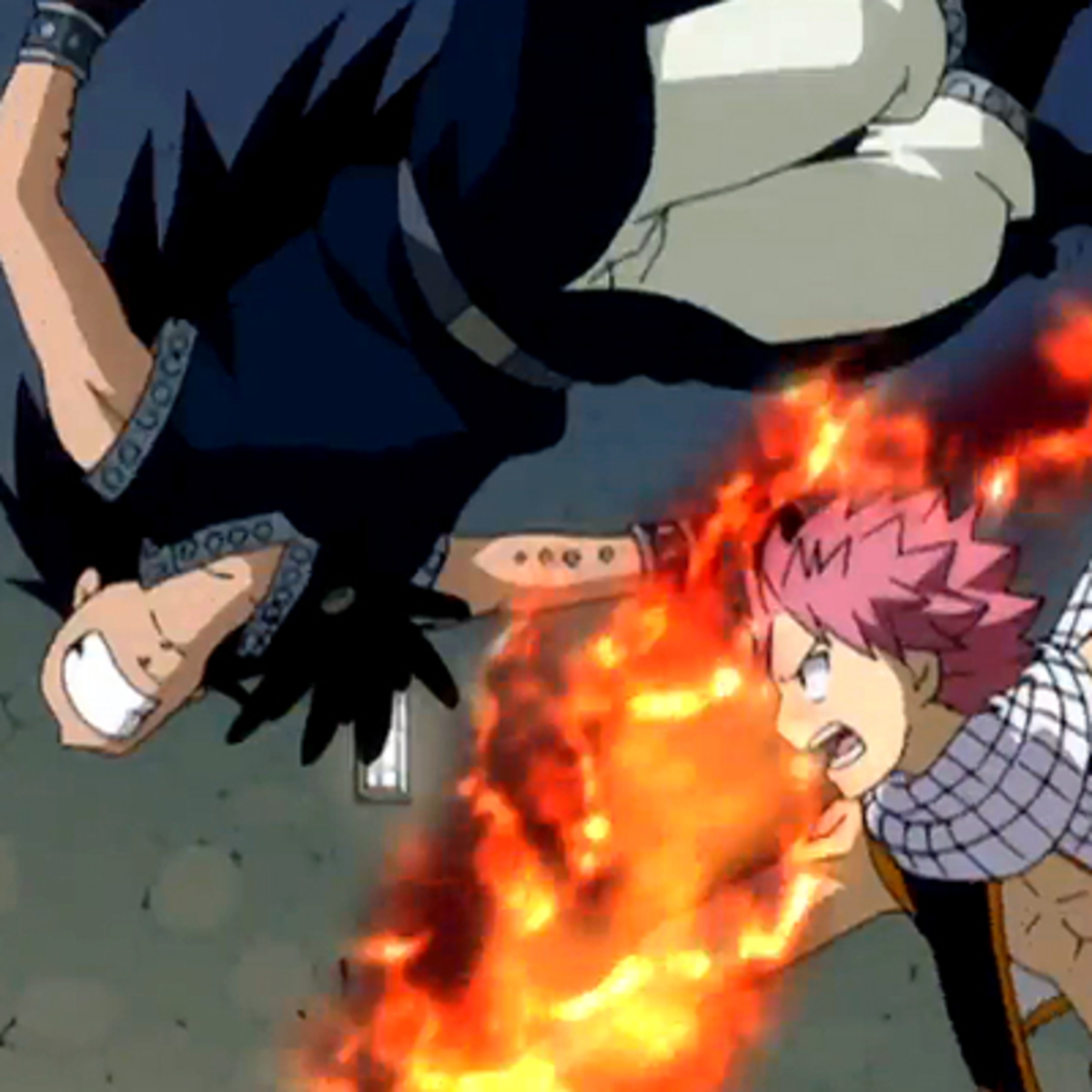 Natsu connecting a fist to Gajeel