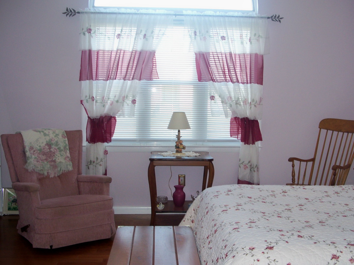 The room is large, so it easily holds a queen sized bed, a table and two chairs for lounging.