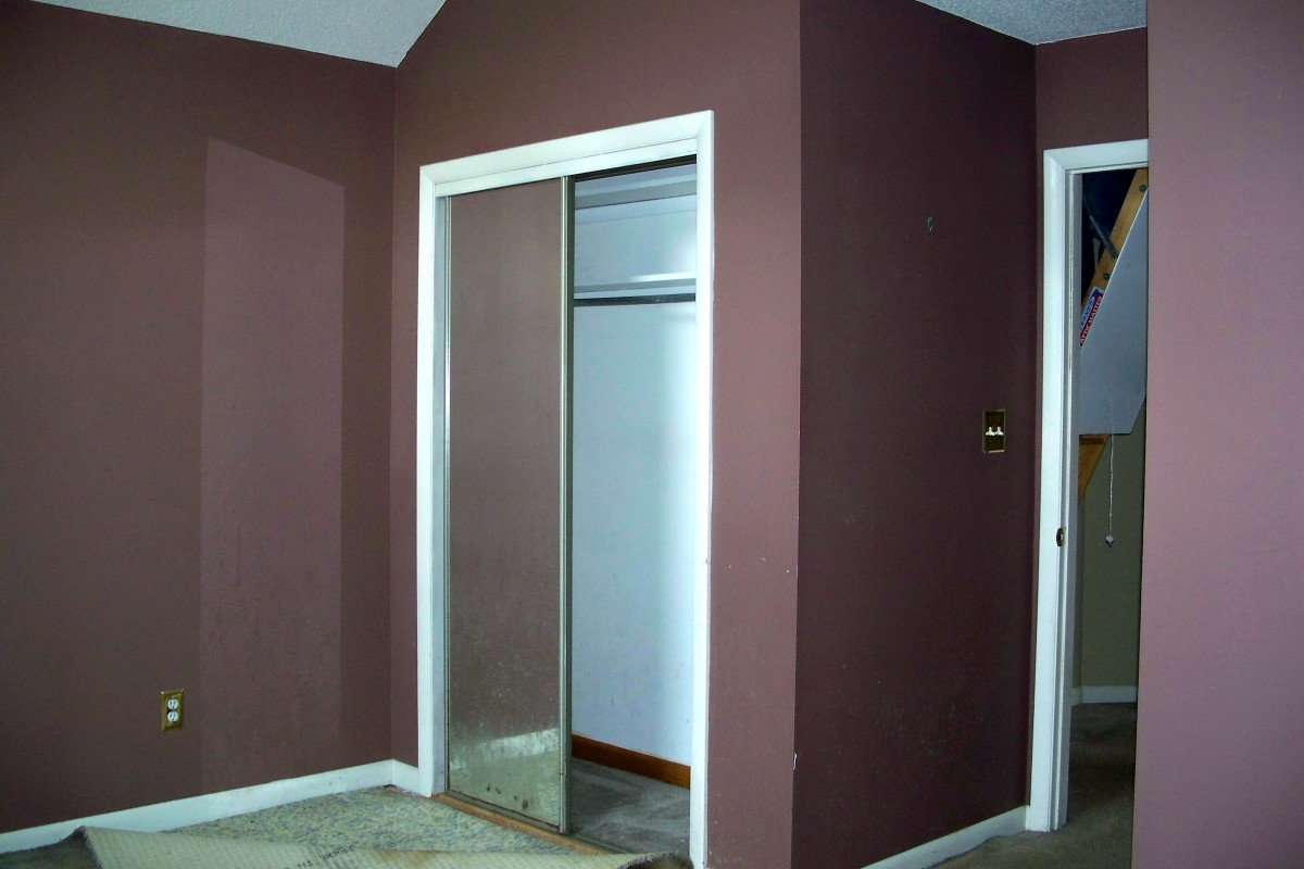 Before: Dark brown walls, carpets ruined by pets and mirrored closet doors needed replacing.