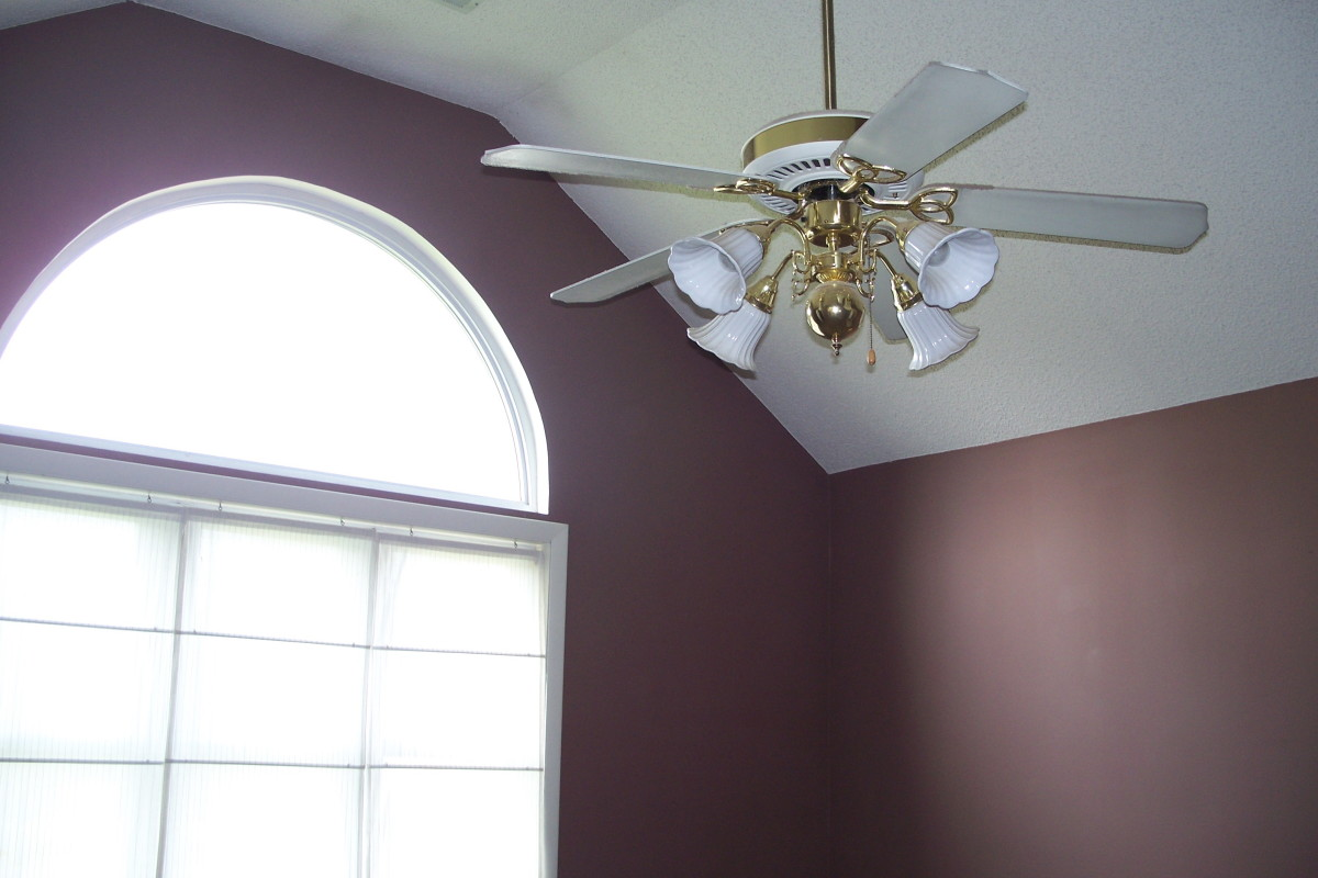Before: Cathedral ceiling and large arched window are two good points in the master bedroom.