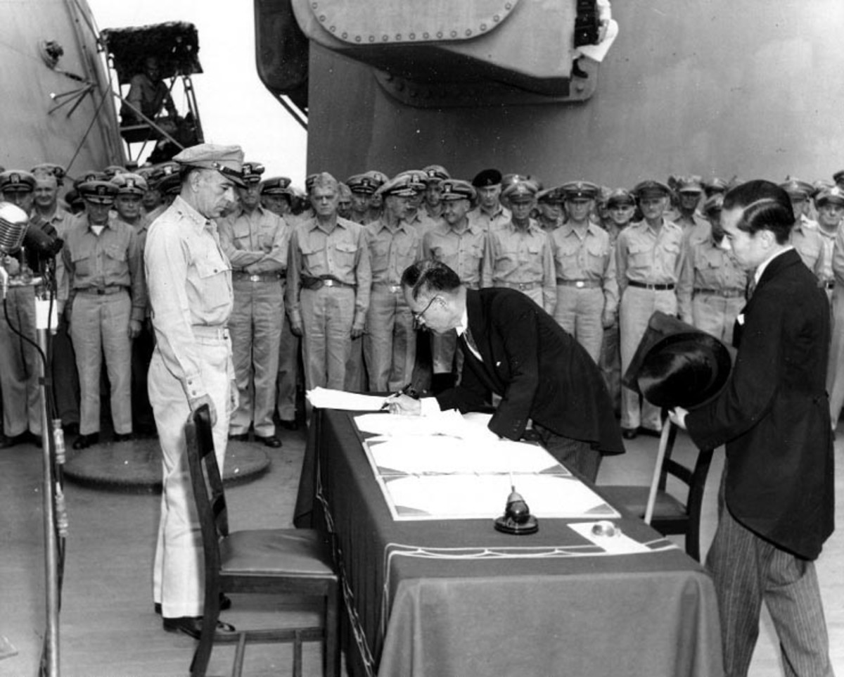 Japanese Foreign Minister Mamoru Shigemitsu makes Japan's unconditional surrender official on board the USS Missouri on the 2nd September 1945.