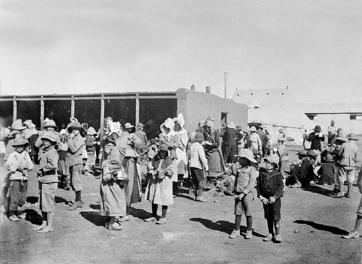 This photo shows Boer women and children living in a British run concentration camp in 1901.