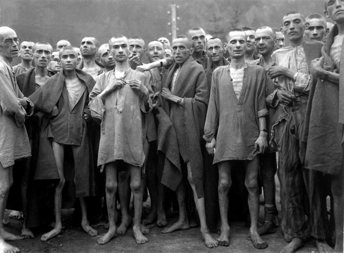 This harrowing photo shows starving prisoners at the Nazi run Mauthausen concentration camp in 1945.