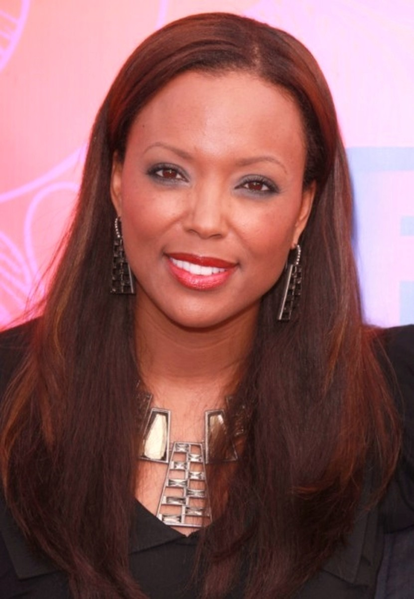 Aisha Tyler. Dyed natural African American hair with highlights.