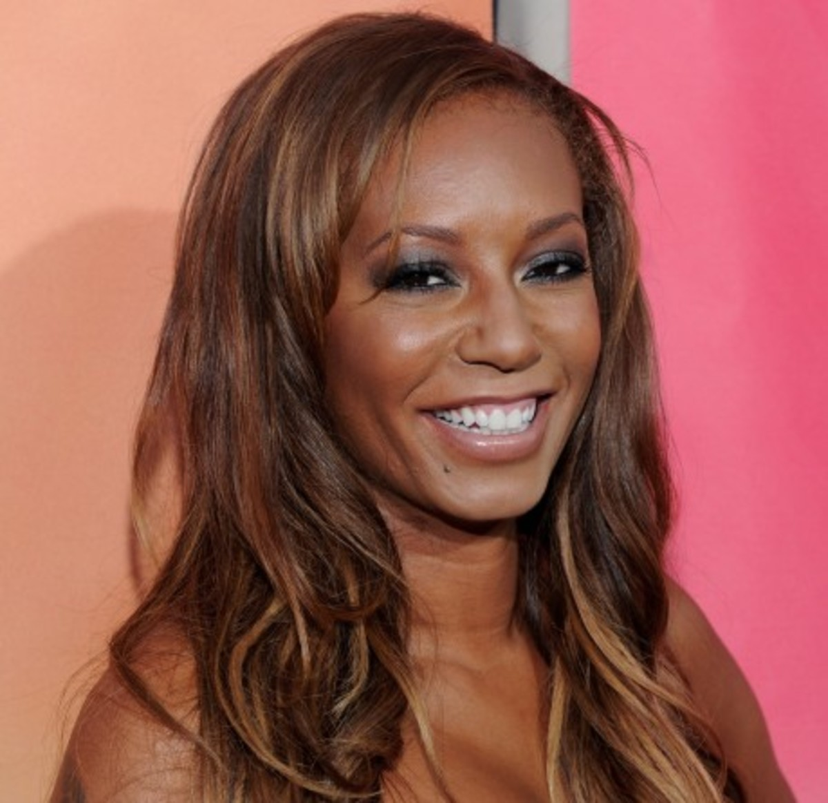 Mel B.Black women with highlights.
