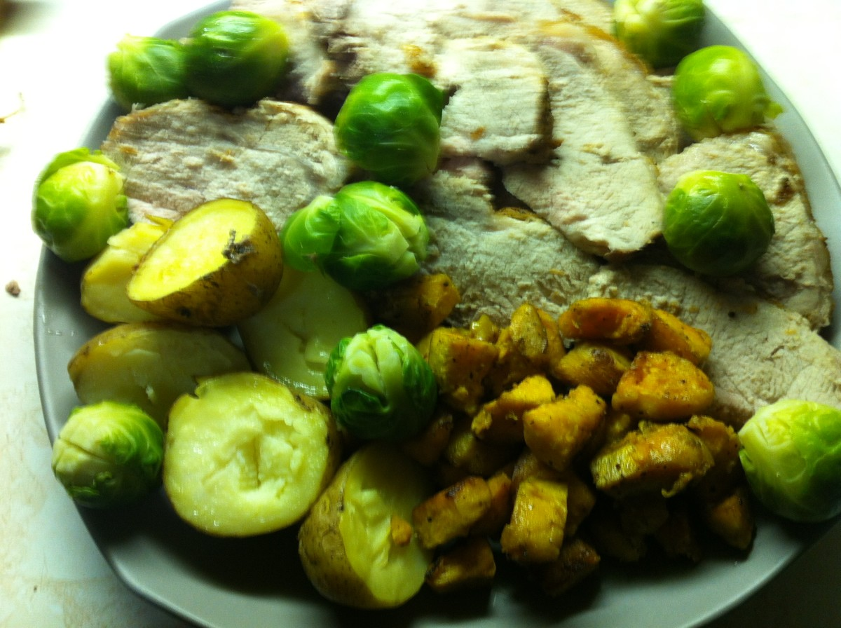 Pork roast, brussels sprouts, roasted potatoes and sweet potatoes