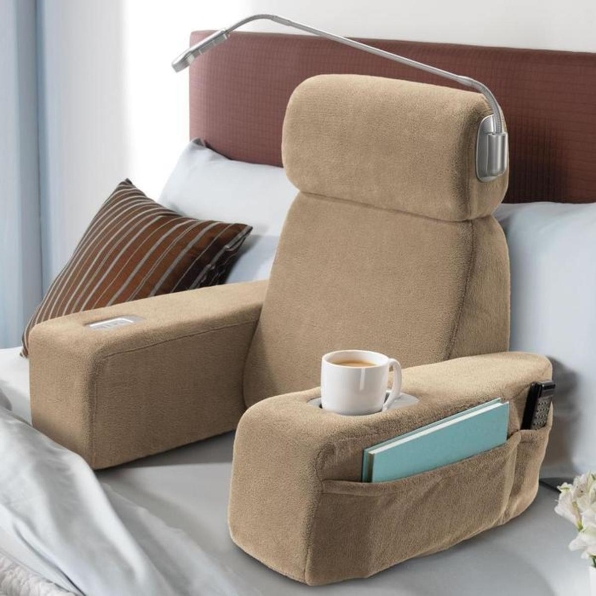 The Nap pillow includes a built-in massager, cup holders, and an LED reading light.