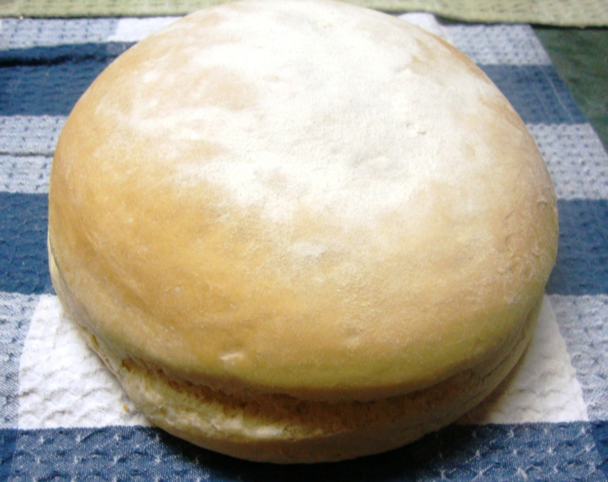 A round loaf dusted with flour.
