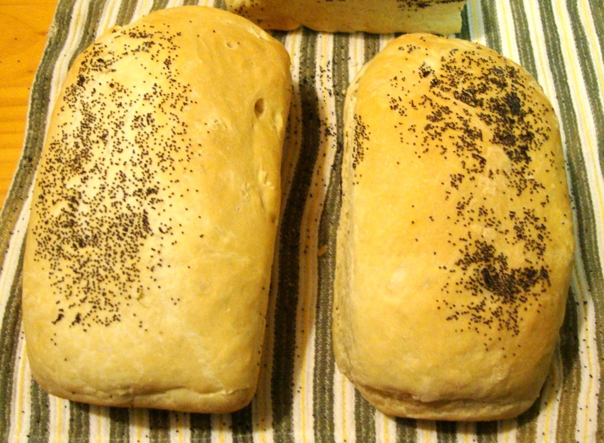 Bread topped with poppy seeds.