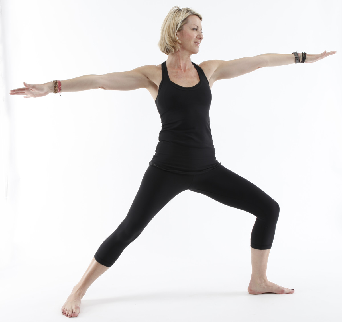 Warrior-II or Virabhadrasana-II increases in intensity and strengthens the legs and spine.