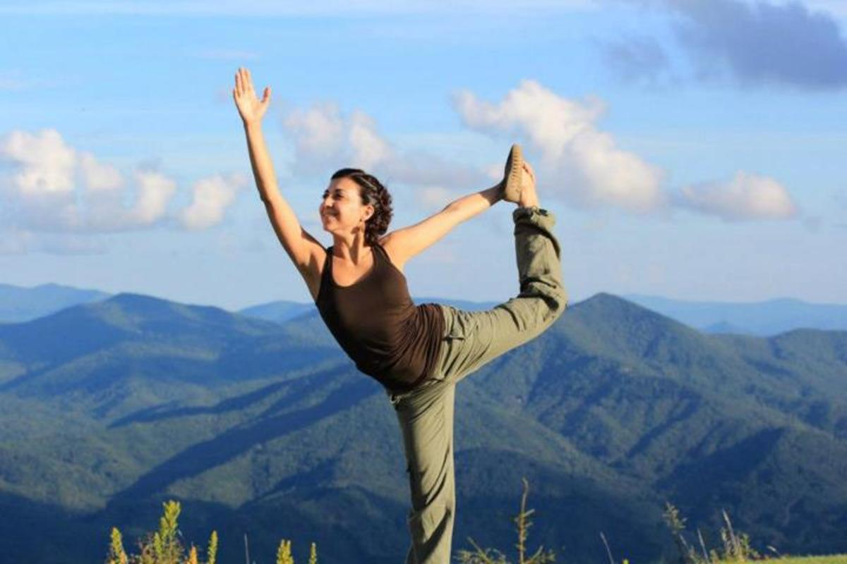 Dancer's Pose or Natarajasana, a balancing standing yoga pose.