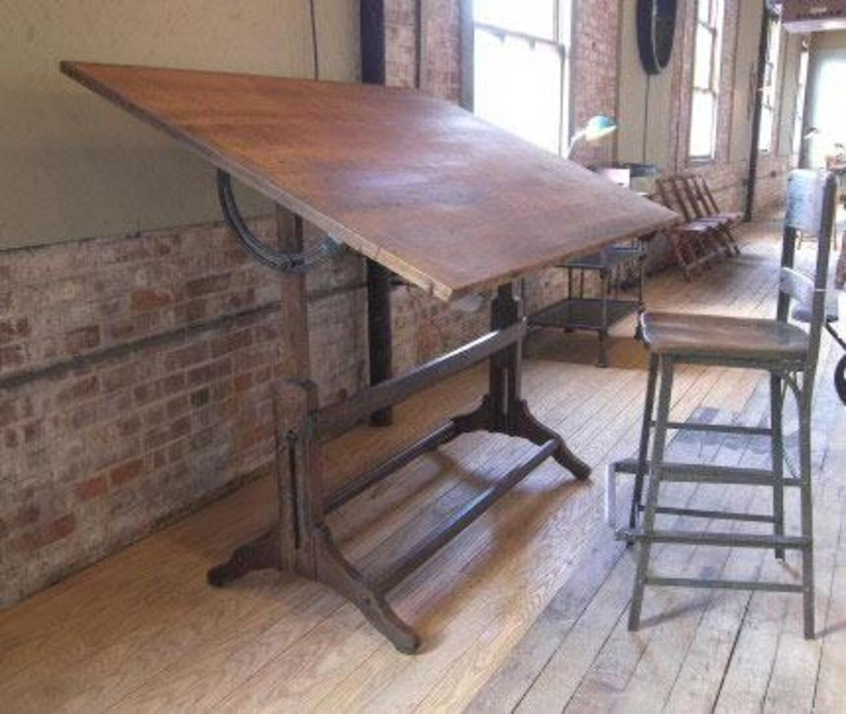 This is a vintage antique industrial drafting desk. Perfect for writing or sketching purposes!