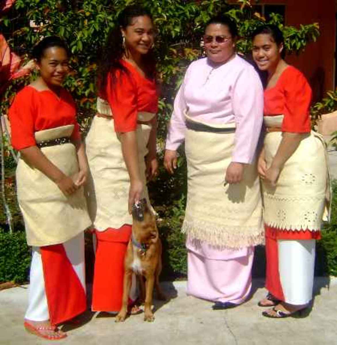 Typical Tongan women formal attire with modest dress, taovala and kafa around waist.