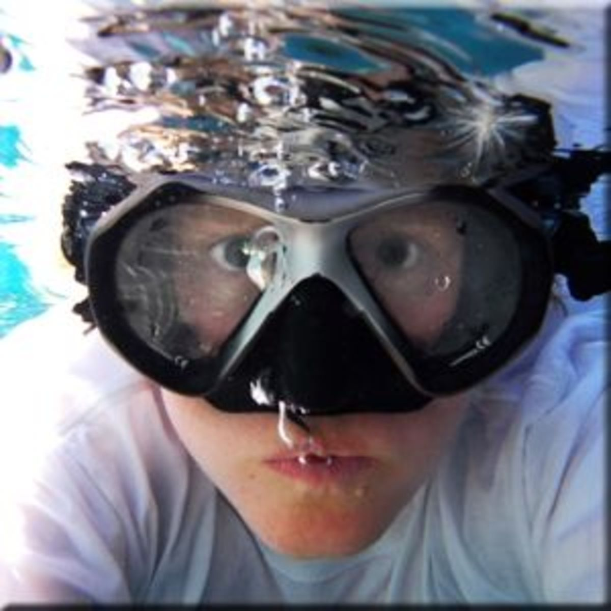 I made this image in our swimming pool using a Nikon Coolpix AW100 waterproof camera held in front of me. But you don't need an underwater camera to take a shot like this. For less than $20, you can buy a waterproof camera bag (see tools section belo
