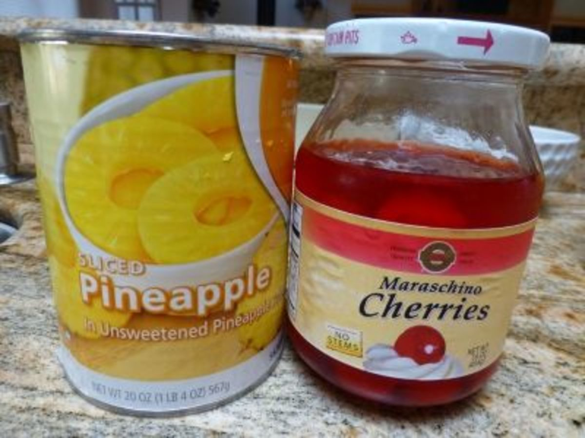 Drain pineapple juice into measuring cup; cut cherries into halves, about 15
