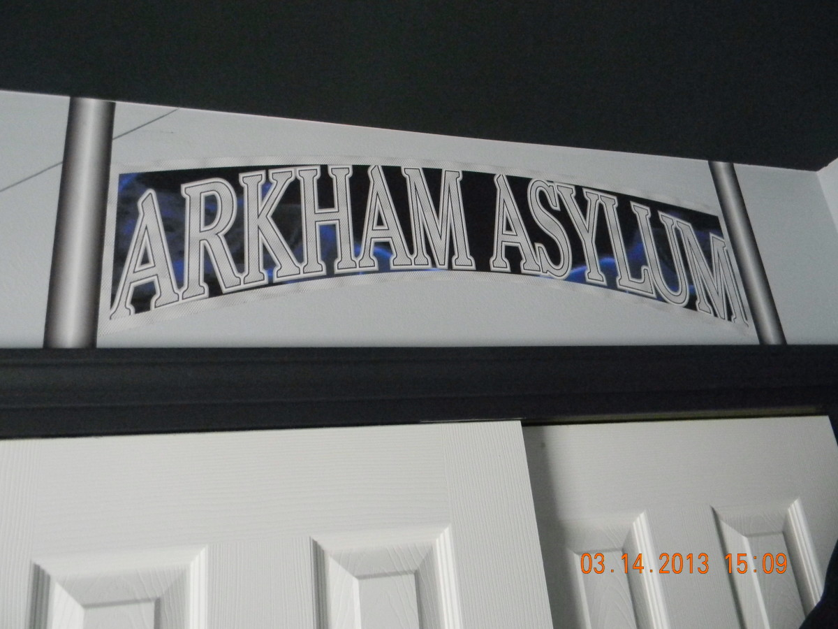 This is the Arkham Asylum sign that is attached over the closet. It was printed on indoor polypropylene and attached with DIF wallcovering adhesive. Here is where Batman places all the villians...and clothing...and toys.