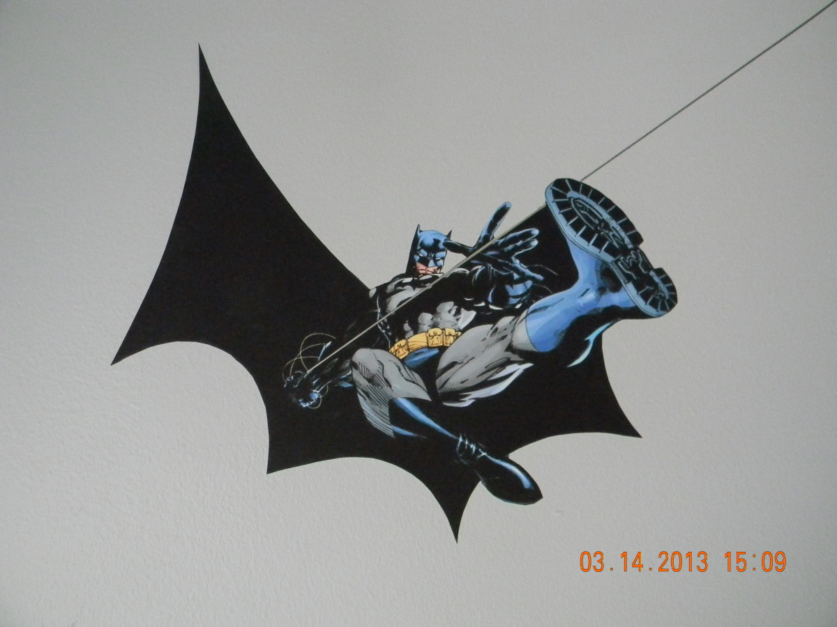 Here you can see 1 of the 2 Batman designs in the room. They were printed on the indoor polypropylene and attached with the DIF wallcovering adhesive. The Dark Knight is swing down on Arkham Asylum.