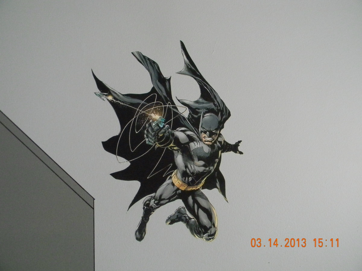 Here you can see 1 of the 2 Batman pieces that was printed on indoor polypropylene and attached with DIF wallcovering adhesive. This one is swinging down on the Gotham skyline.