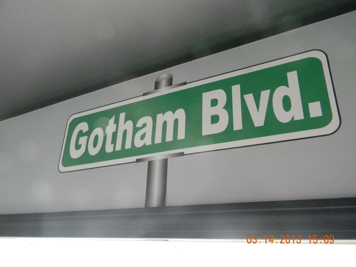Here is the Gotham Blvd sign above the window announcing that you are in Batman's home city of Gotham.