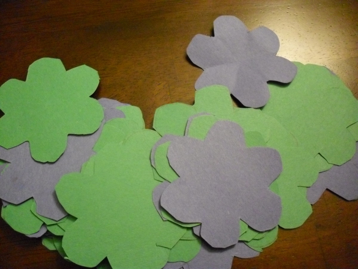 Compile several cut out flower shapes. The more you have the easier it is to put together a bunch of flowers quickly!