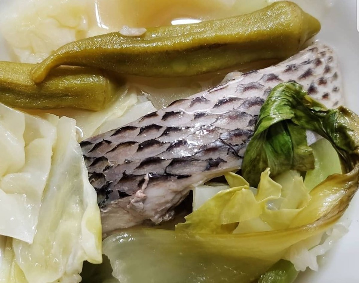 Sinigang can be either meat or fish. Just like this tilapia cooked with powdered tamarind as the souring agent with okra, bok choy and cabbage for veggies.