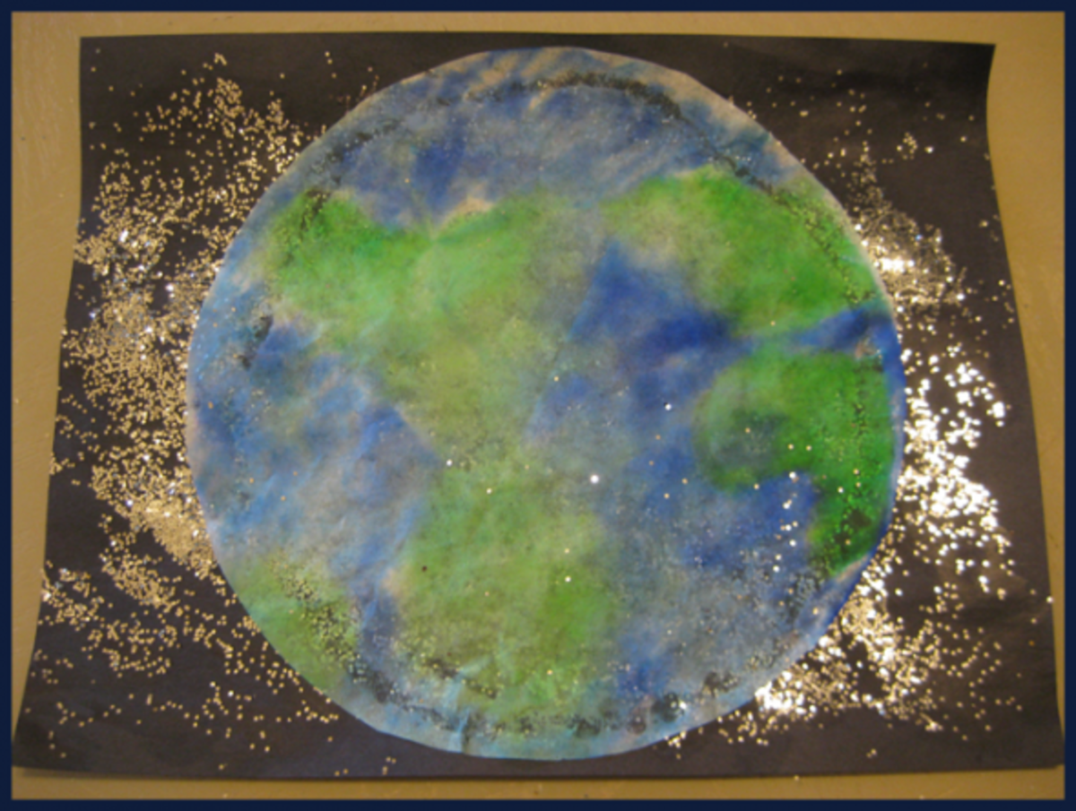 "The finished Earth, glued onto a piece of black construction paper covered with glitter ""stars."""