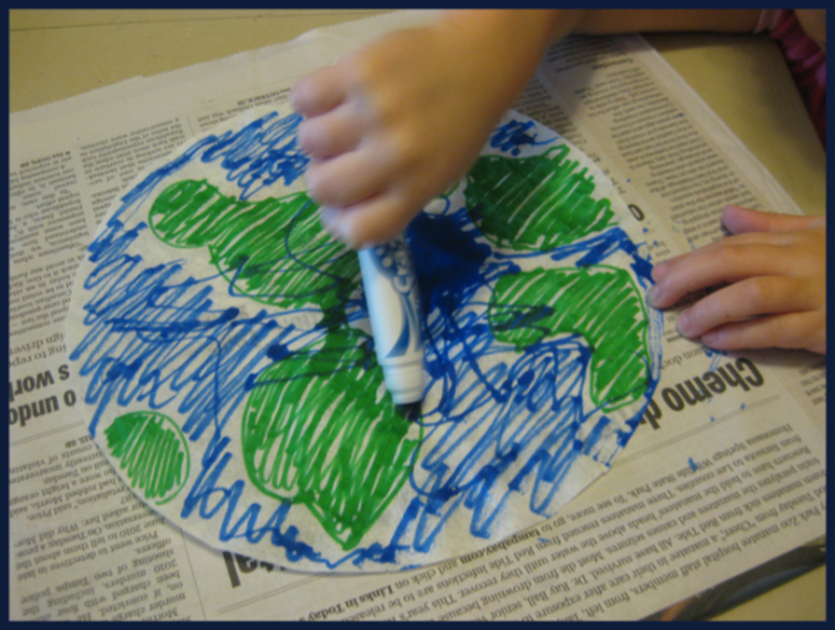Coloring the coffee filter with washable markers.