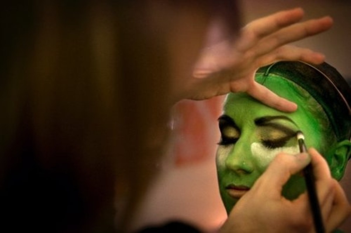 Makeup in progress for the witch 'Elphaba' in the musical Wicked.