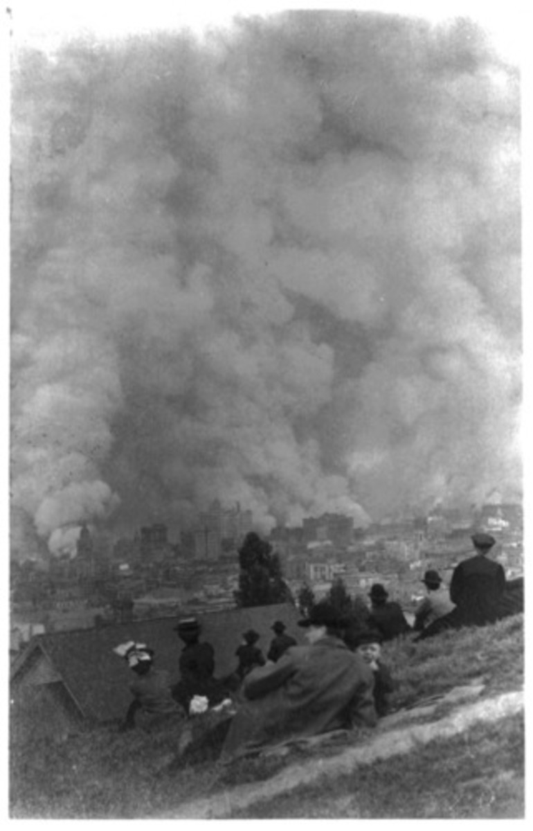 Spectators sitting on the hillside, watching fires