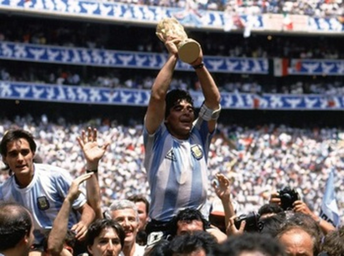 Maradona lifting the World Cup trophy in 1986.