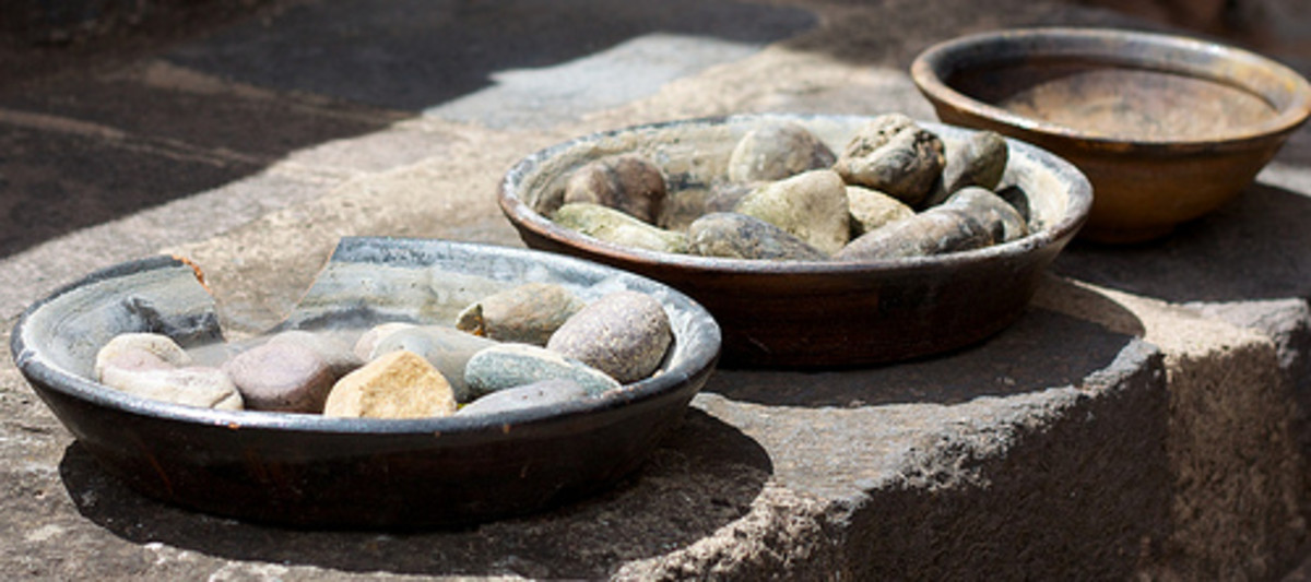 Gather interesting stones to fill your decorated vases.