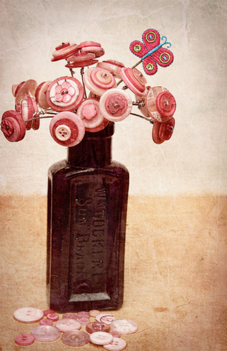 Button flowers are a fun option for glass jar vases.