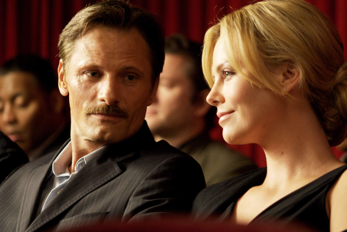 The Man (Viggo Mortensen) and his wife (Charlize Theron) © Dimension/Weinstein