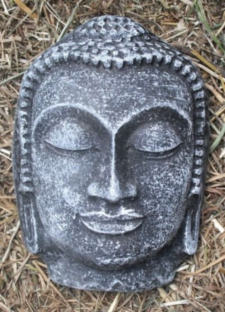 Buddha face painted black-dry brushed green ready to be hung. I put a wire loop, in back before it set.