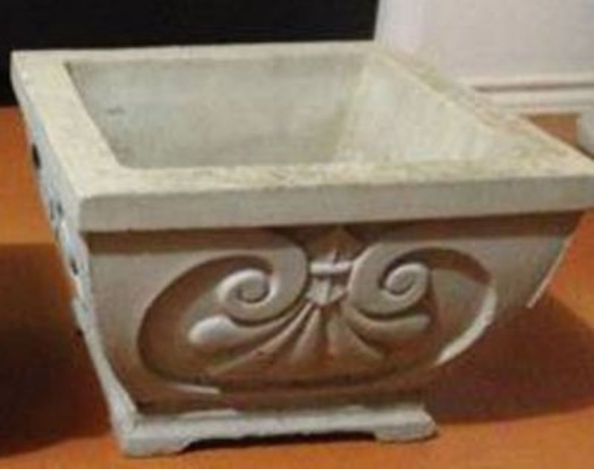 A planter elegant and easy to make with less than 1 bag of concrete.  Not bad at $2.58.