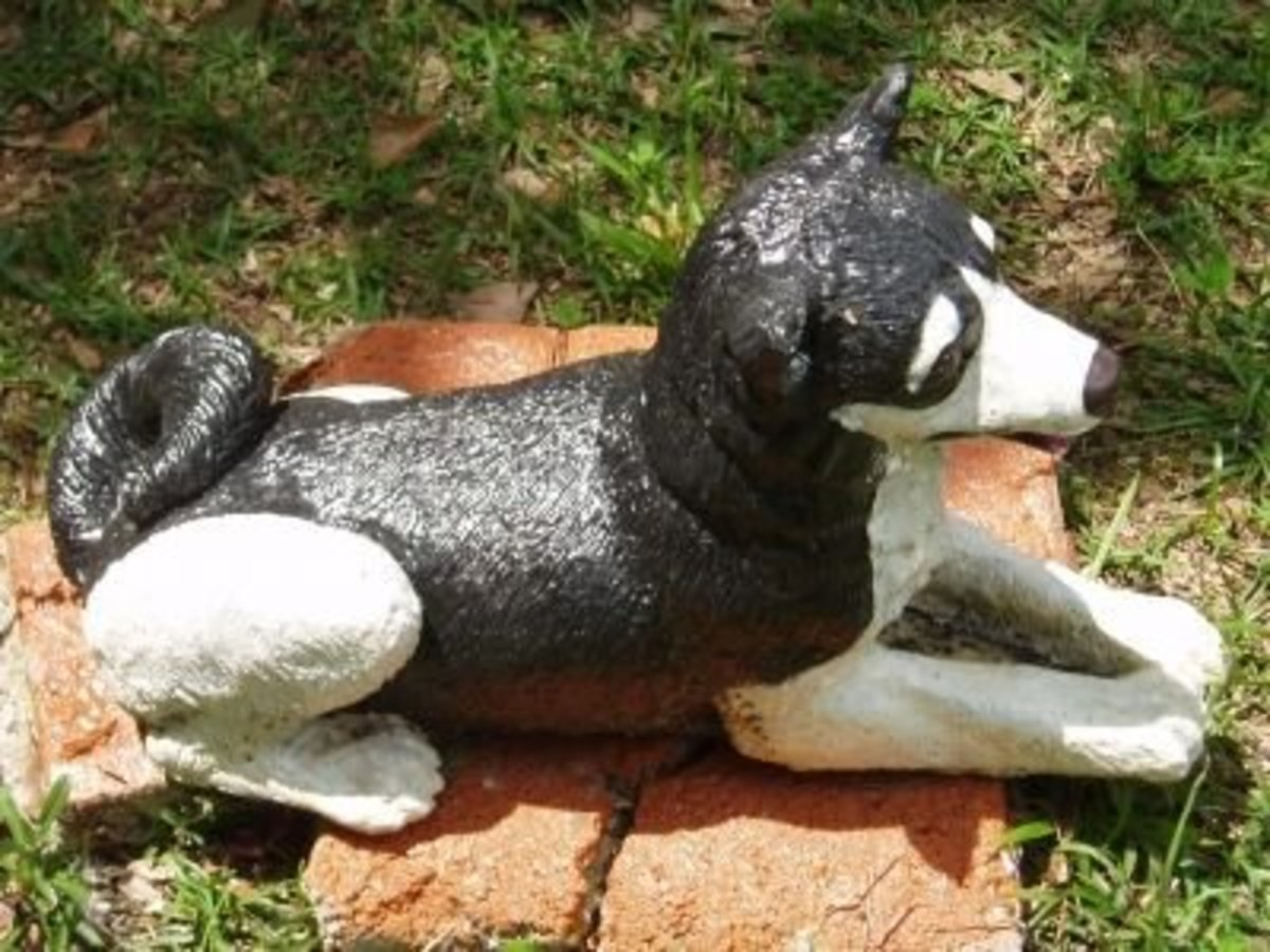 I painted this dog with craft paint and used concrete sealer.  He looks like my dog, sometimes I think it Scooter