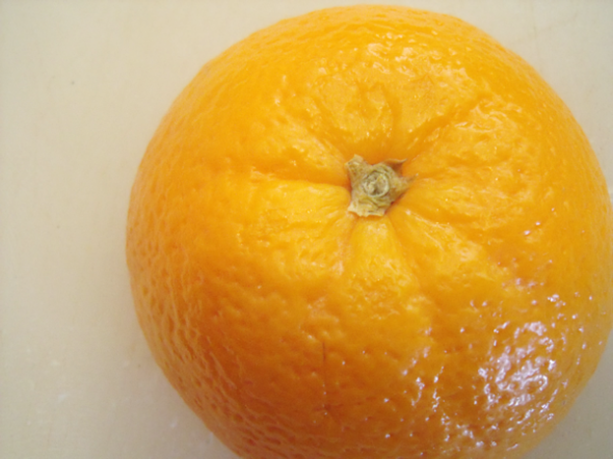 The top half of the orange has a thicker stem