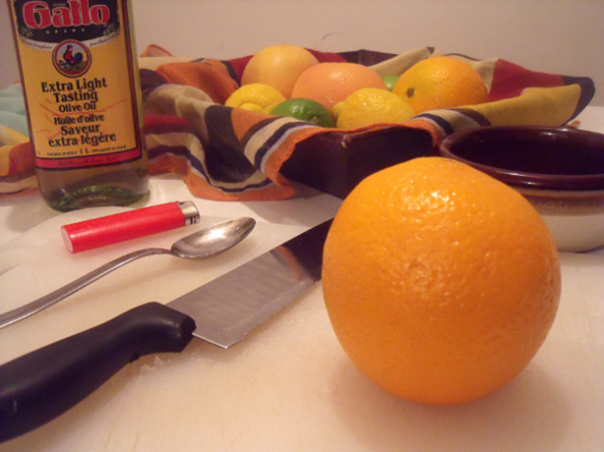 Kitchen ingredients needed for making a natural citrus fruit candle