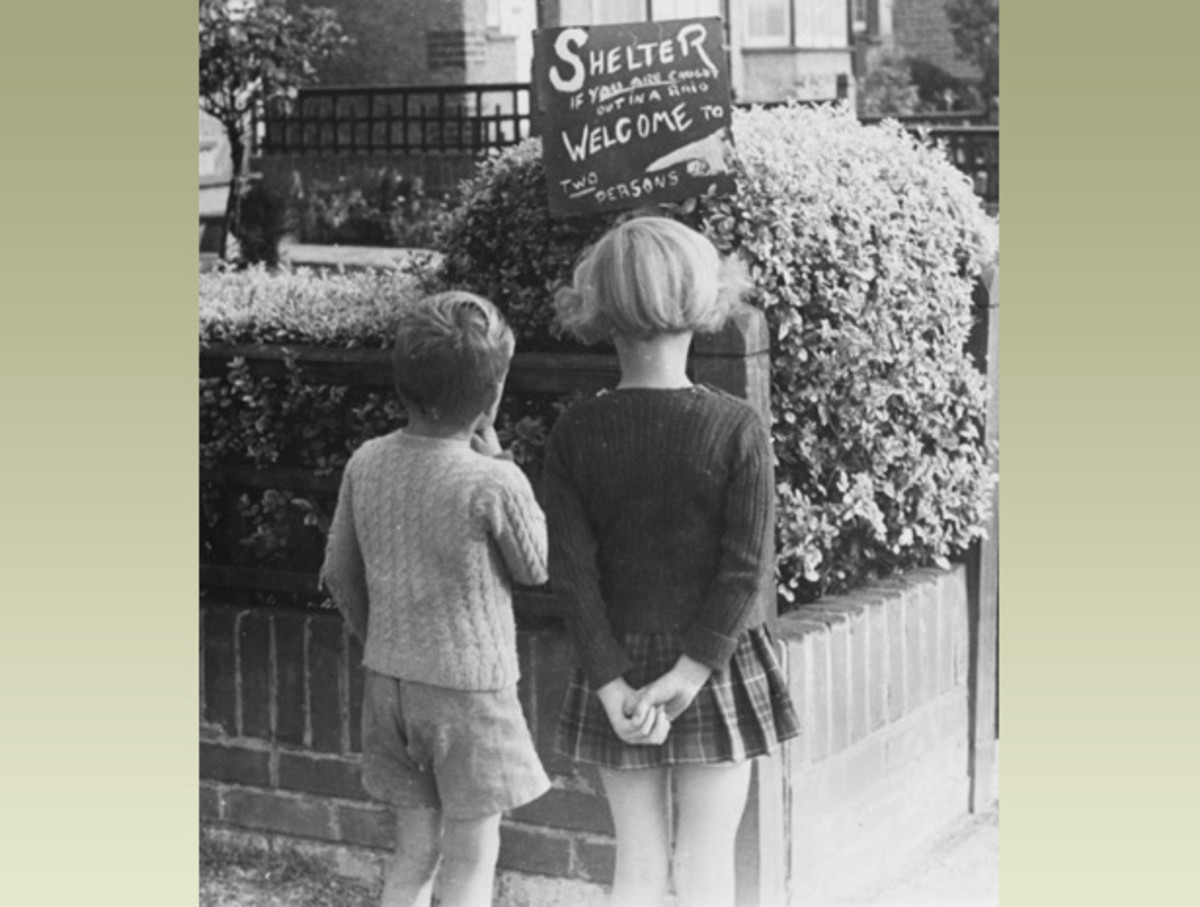 Two children looking at a sign offering shelter for a homeless family